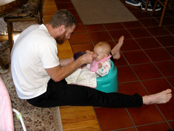 feeding-an-infant-on-the-floor